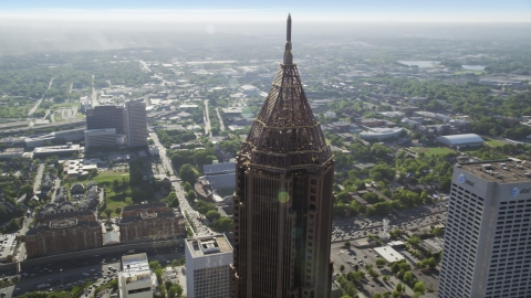 AX38_077.0000112F - Aerial stock photo of Top of Bank of America Plaza, Midtown Atlanta, Georgia