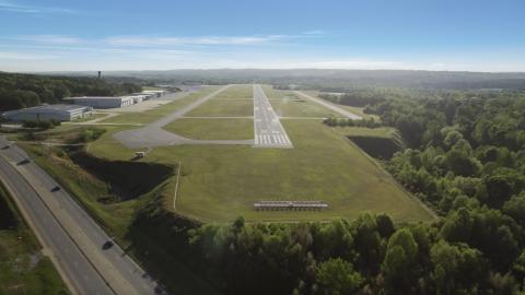 AX38_085.0000132F - Aerial stock photo of Runway at Fulton County Airport, Atlanta, Georgia
