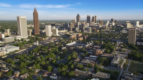 AX39_028.0000034F - Aerial stock photo of Midtown and Downtown Atlanta skyscrapers behind Bobby Dodd Stadium, Atlanta, Georgia