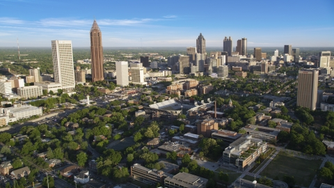 AX39_028.0000127F - Aerial stock photo of Midtown and Downtown Atlanta skyscrapers behind the Bobby Dodd Sports Stadium, Atlanta, Georgia