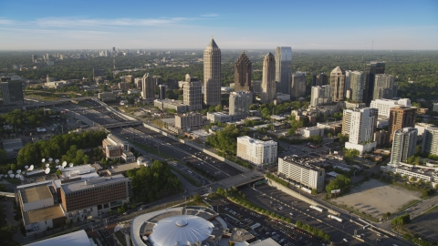 AX39_030.0000011F - Aerial stock photo of I-85 and Midtown Atlanta skyscrapers in Georgia