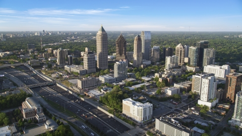 AX39_030.0000141F - Aerial stock photo of The I-85 freeway and Midtown Atlanta skyscrapers in Georgia