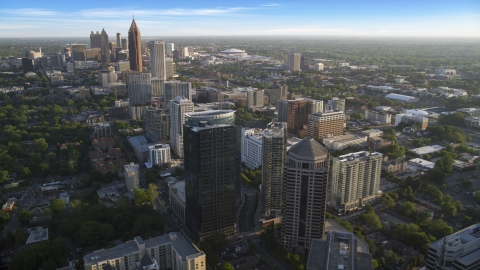 AX39_033.0000165F - Aerial stock photo of Midtown Atlanta skyscrapers with Downtown in the background, Georgia