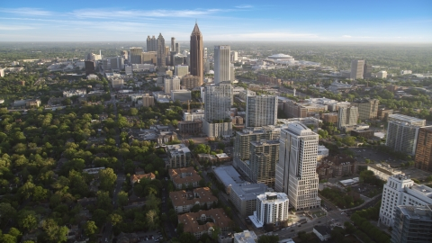 AX39_034.0000032F - Aerial stock photo of Midtown Atlanta buildings with Downtown Atlanta in the background, Georgia