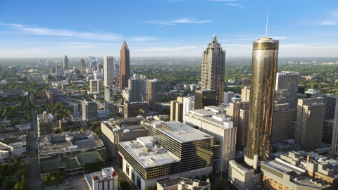 AX39_047.0000126F - Aerial stock photo of Westin Peachtree Plaza Hotel and SunTrust Plaza among high-rises, Downtown Atlanta