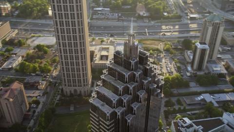 AX39_054.0000211F - Aerial stock photo of Close up of the top of Promenade II, Midtown Atlanta, Georgia