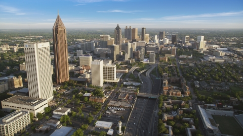 AX39_063.0000068F - Aerial stock photo of Downtown Connector and Downtown skyscrapers in the distance, Atlanta, Georgia