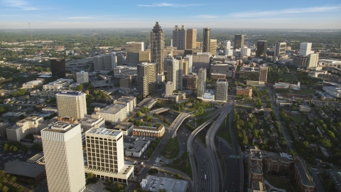 AX39_063.0000317F - Aerial stock photo of Downtown Connector toward Downtown skyscrapers, Atlanta