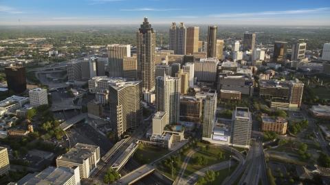 AX39_064.0000211F - Aerial stock photo of SunTrust Plaza and Downtown Atlanta skyscrapers, Georgia, haze