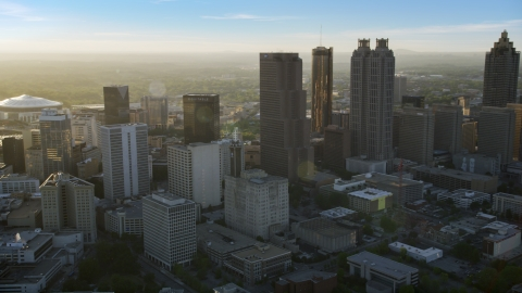 AX39_066.0000060F - Aerial stock photo of Downtown Atlanta skyscrapers at sunset with hazy skies, Georgia