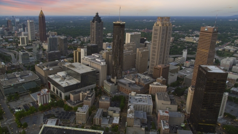 AX40_004.0000430F - Aerial stock photo of Westin Peachtree Plaza Hotel and skyscrapers in Downtown Atlanta, Georgia, twilight