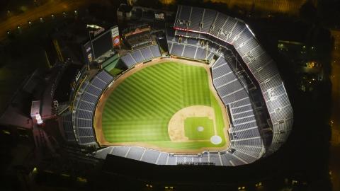 AX41_004.0000298F - Aerial stock photo of Empty Turner Field baseball stadium at night, Atlanta, Georgia