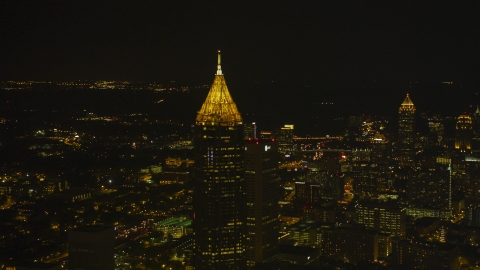 AX41_021.0000078F - Aerial stock photo of Bank of America Plaza skyscraper at night in Midtown Atlanta, Georgia