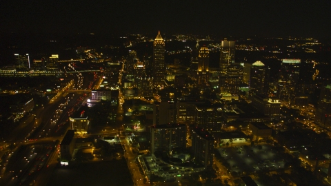 AX41_027.0000019F - Aerial stock photo of Tall skyscrapers and city buildings in Midtown Atlanta, Georgia, night