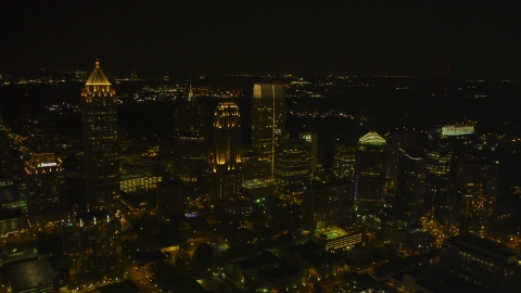 AX41_028.0000078F - Aerial stock photo of A group of skyscrapers at night in Midtown Atlanta, Georgia