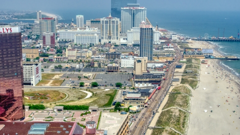 AXP071_000_0017F - Aerial stock photo of The boardwalk by hotels in Atlantic City, New Jersey