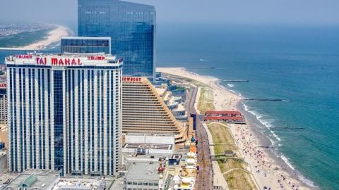 AXP071_000_0018F - Aerial stock photo of Trump Taj Mahal by the boardwalk and beach in Atlantic City, New Jersey