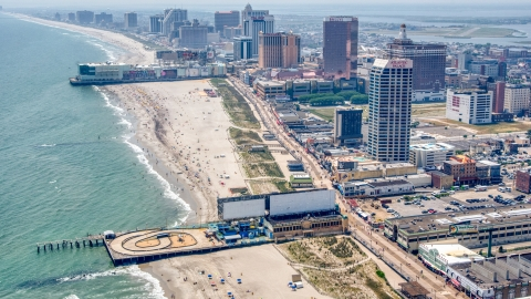 AXP071_000_0021F - Aerial stock photo of Central Pier, Playground Pier and hotels in Atlantic City, New Jersey
