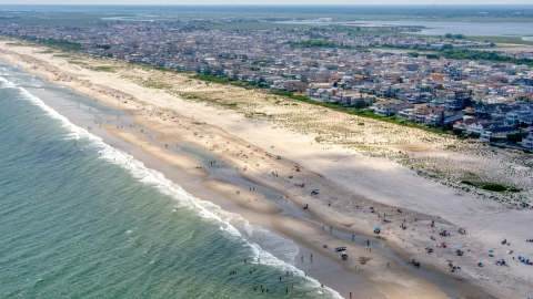 AXP071_000_0024F - Aerial stock photo of People on the beach and beachfront homes in Ocean City, New Jersey