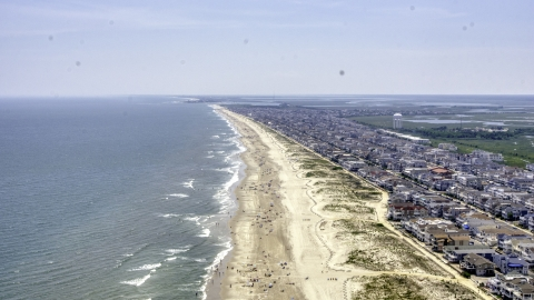 AXP071_000_0025F - Aerial stock photo of Beach goers and beachfront neighborhoods in Ocean City, New Jersey
