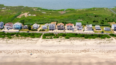 AXP071_000_0026F - Aerial stock photo of Beachfront homes in Strathmere, New Jersey