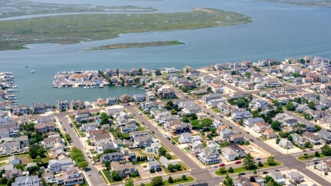 AXP071_000_0029F - Aerial stock photo of Waterfront homes by Snug Harbor in Stone Harbor, New Jersey