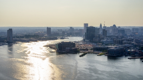 AXP073_000_0009F - Aerial stock photo of The Patapsco River and Downtown Baltimore skyline, Maryland