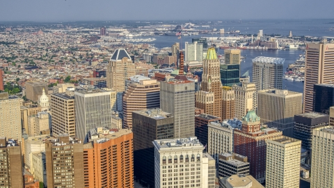 AXP073_000_0012F - Aerial stock photo of Schaefer Tower and Bank of America Building in Downtown Baltimore, Maryland