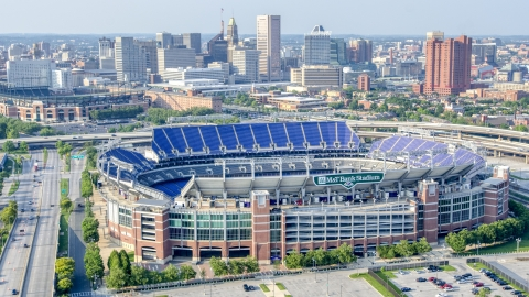 AXP073_000_0021F - Aerial stock photo of M&T Bank Stadium with Downtown Baltimore skyscrapers in the background, Maryland
