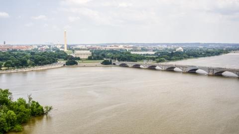 AXP074_000_0011F - Aerial stock photo of The Washington Monument, Lincoln Memorial, and Arlington Memorial Bridge in Washington DC
