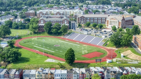AXP075_000_0014F - Aerial stock photo of McKinley Technology High School and football field in Washington DC