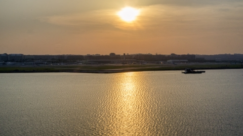 AXP076_000_0005F - Aerial stock photo of Ronald Reagan Washington National Airport, Arlington, Virginia, sunset