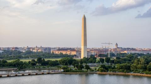 AXP076_000_0009F - Aerial stock photo of The Washington Monument seen from Tidal Basin, Washington D.C., sunset