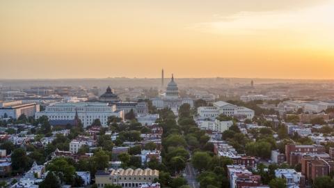 AXP076_000_0015F - Aerial stock photo of Library of Congress, United States Capitol, Washington Monument, Supreme Court, Washington D.C., sunset