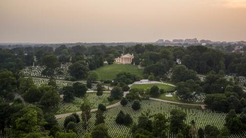 AXP076_000_0025F - Aerial stock photo of Rows of gravestones near Arlington House at Arlington National Cemetery, Arlington, Virginia, twilight