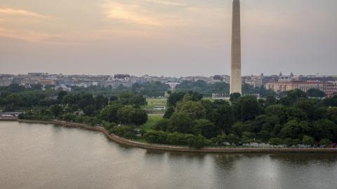 AXP076_000_0026F - Aerial stock photo of The Washington Monument and White House seen from Tidal Basin, Washington D.C., twilight