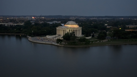 AXP076_000_0034F - Aerial stock photo of The Jefferson Memorial lit up for evening, Washington, D.C., twilight