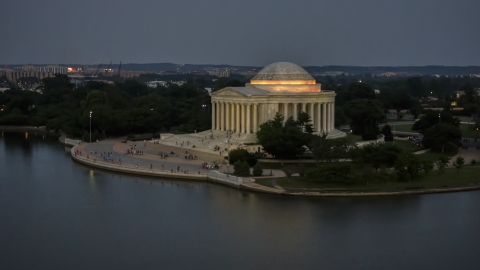 AXP076_000_0035F - Aerial stock photo of The Jefferson Memorial lit up at twilight in Washington, D.C.