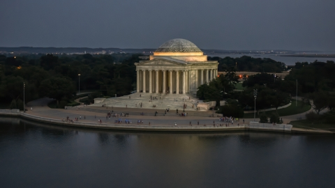 AXP076_000_0036F - Aerial stock photo of The front of the Jefferson Memorial lit up for the night, Washington, D.C., twilight