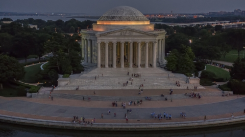 AXP076_000_0037F - Aerial stock photo of Visitors at the Jefferson Memorial, lit up at twilight in Washington, D.C.