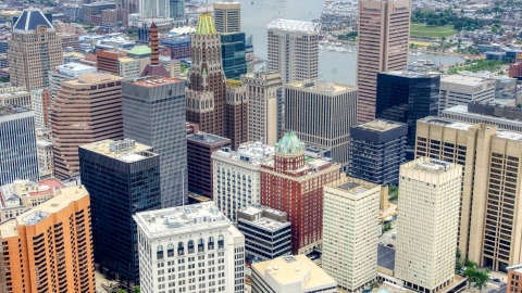 AXP078_000_0006F - Aerial stock photo of Skyscrapers and city buildings in Downtown Baltimore, Maryland