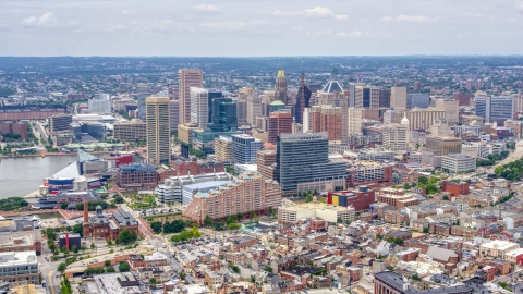AXP078_000_0013F - Aerial stock photo of Skyscrapers and city buildings in the Downtown Baltimore skyline, Maryland