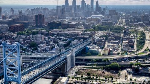 AXP079_000_0002F - Aerial stock photo of The Benjamin Franklin Bridge with the skyline of Downtown Philadelphia in the background, Pennsylvania