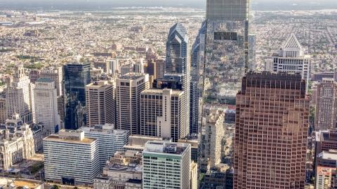 AXP079_000_0004F - Aerial stock photo of Comcast Center towering over Downtown Philadelphia skyscrapers, Pennsylvania