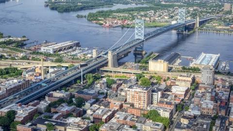 AXP079_000_0011F - Aerial stock photo of The Benjamin Franklin Bridge spanning the Delaware River between Philadelphia, Pennsylvania and Camden, New Jersey