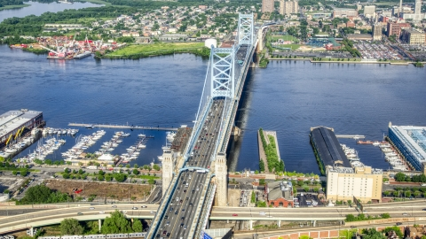 AXP079_000_0012F - Aerial stock photo of The Benjamin Franklin Bridge over the Delaware River between Philadelphia, Pennsylvania and Camden, New Jersey