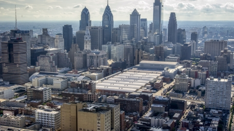 AXP079_000_0013F - Aerial stock photo of The Philadelphia Convention Center and the Downtown Philadelphia skyline, Pennsylvania