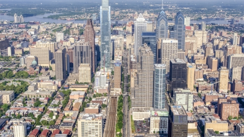 AXP079_000_0016F - Aerial stock photo of Talk towers and city buildings in downtown Philadelphia, Pennsylvania