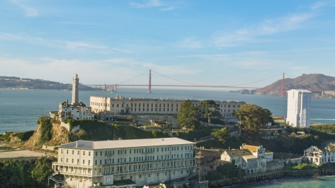 DCSF05_029.0000240 - Aerial stock photo of Alcatraz with the Golden Gate Bridge in the far distance, San Francisco, California