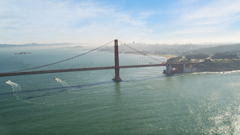 DCSF05_037.0000043 - Aerial stock photo of The Golden Gate Bridge with the downtown skyline in the background, San Francisco, California